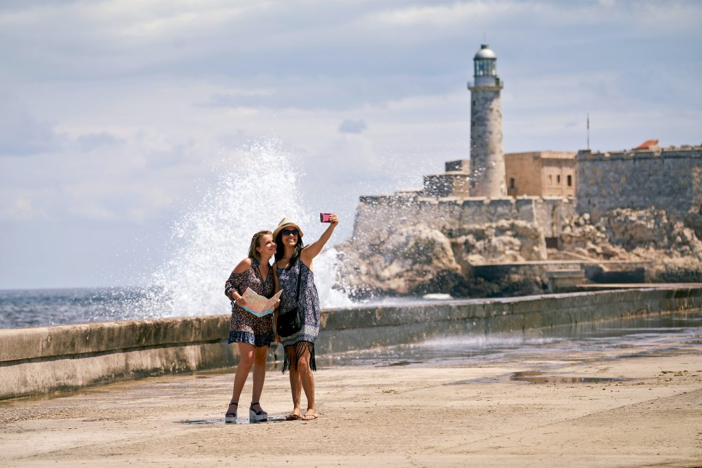 Two female students taking a selfie by the water in Cuba.