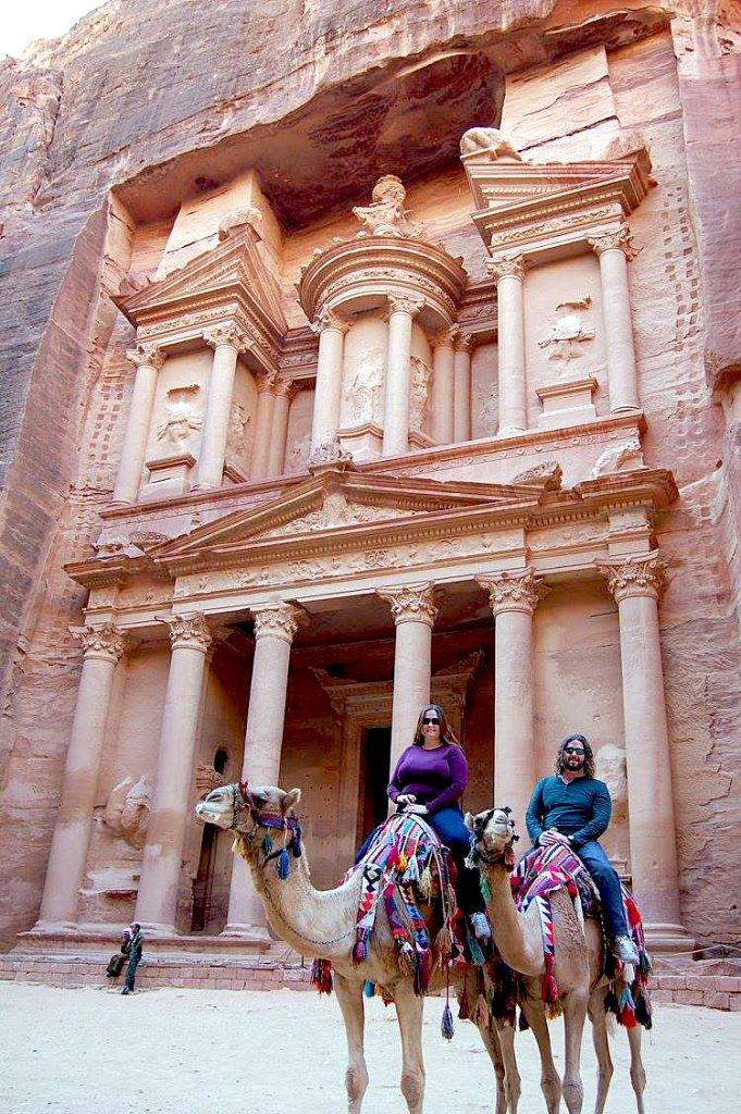 FTI's Vice President Jeremy & his wife Stephanie on camels in front of Petra.