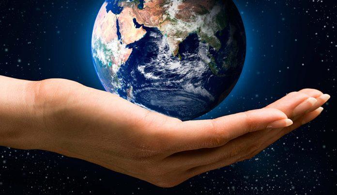 Globe resting in hand.