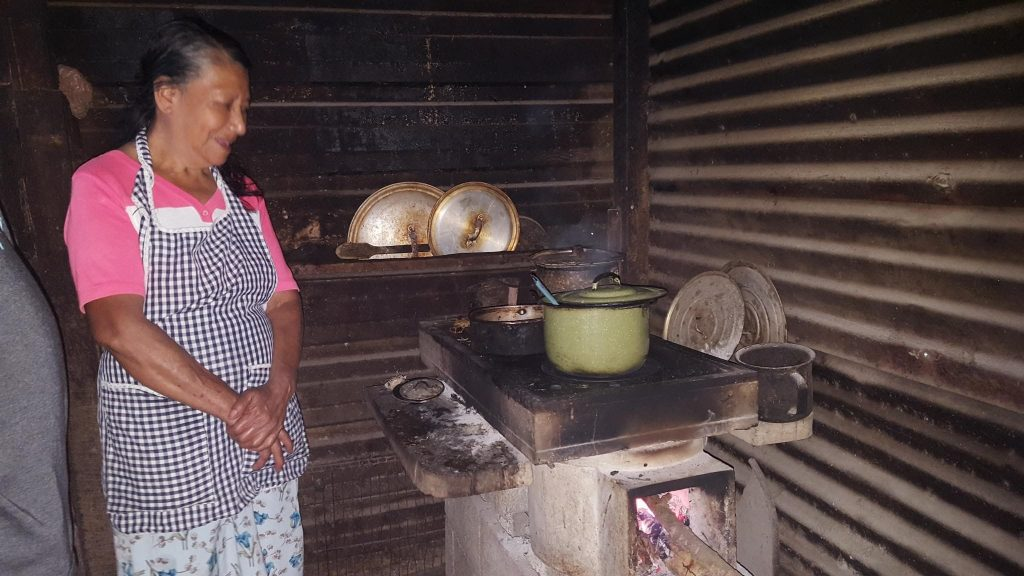 A village woman enjoying her new stove.