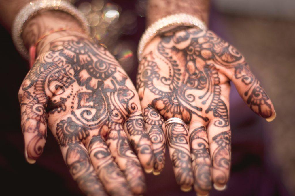 Henna hand tattoos.