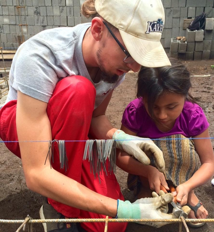 Alex Pinaretta working with a Guatemalan child during a service trip.