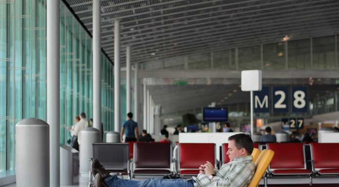 Man lounging in an airport