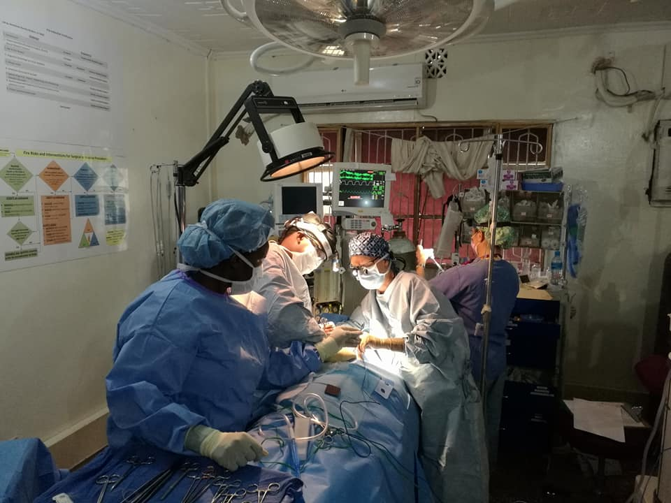 Surgeons performing a late-night operations.