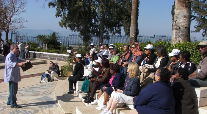 Pastor preaching to his congregation in Israel