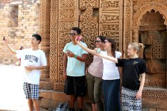 Students taking selfies in India