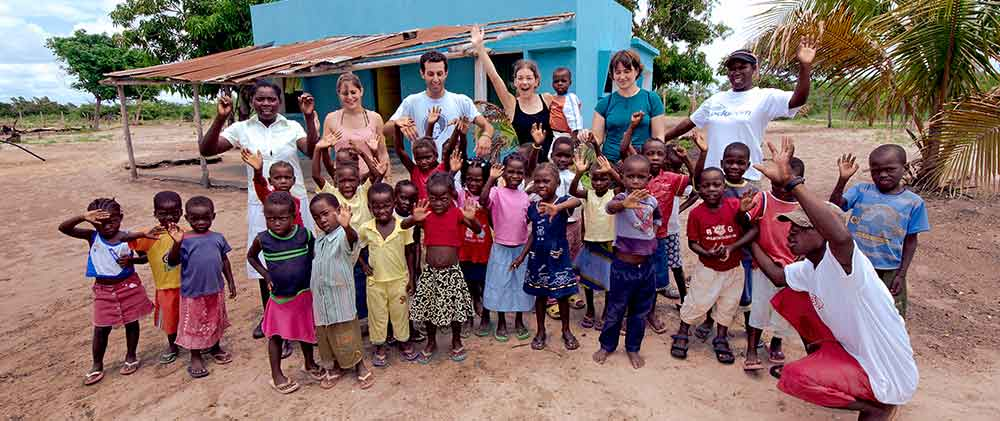 Students & children waving in Africa new