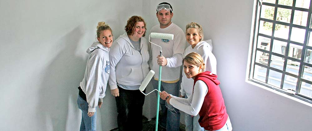 A mission team painting local facilities during their trip