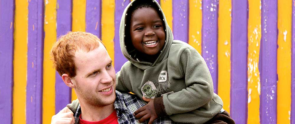 Missionary playing with a young boy in Kenya